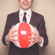 Businessman with beach ball — Stock Photo #45258265