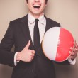Businessman with beach ball — Stock Photo #45258315