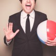 Businessman with beach ball — Stock Photo #45258563