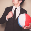 Businessman with beach ball — Stock Photo #45258641