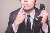 Businessman on the phone is thinking — Stock Photo