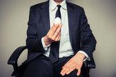 Businessman holding an egg — Stock Photo