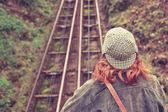 Woman looking at a cliff rail — Stock Photo