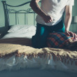 Постер, плакат: Man abusing his wife on a bed