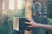Hand touching a gravestone — Stock Photo