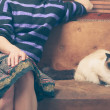 Young woman and cat on sofa — Stock Photo #46646253