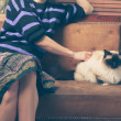 Young woman and cat on sofa — Stock Photo #46646553