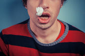 Man with nose bleed and cold sores — Stock Photo
