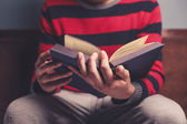 Man is reading a big book — Stock Photo