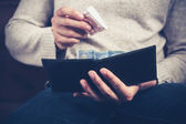 Man getting money out of his wallet — Stock Photo