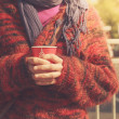 Young woman is standing in the street with a cup — Stock Photo
