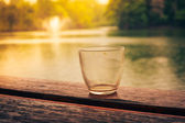 Empty glass by the lake — Stock Photo