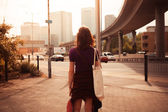 Young woman walking by the roadside — Stock Photo