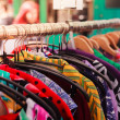 Clothes on a rail at street market — Stock Photo #48610649