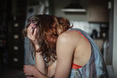 Sad woman at home with a head ache — Stock Photo