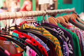Clothes on a rail at street market — Stock Photo