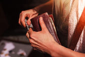 Woman holding her wallet outdoors — Foto Stock