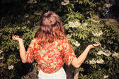Young woman is picking elderflowers — Stock Photo