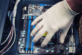 Hand fixing computer components — Stockfoto