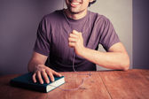 Young man listening to audio book — Stock Photo