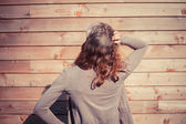 Confused young woman outside wooden cabin — Stock Photo