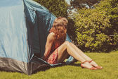 Young woman sitting in a tent  — Stock Photo