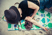 Young woman relaxing on the beach — Stock Photo
