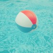 Beach ball floating in swimming pool — Stock Photo #49061767