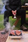 Senior man at barbecue — Stock Photo