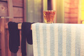 Towel drying outside on porch with a glass — Stock Photo