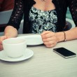 Woman having coffee waiting for phone call — Stock Photo #49287481