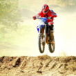 Stock Photo: Man on motocross bike