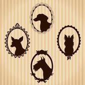Dogs vintage silhouettes — Stock Vector