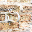 Pipe straps on old concrete vintage brick wall background — Stock Photo
