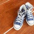 Blue sneakers on the floor wood balcony   — Stock Photo