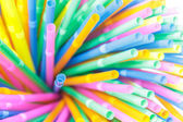 Colorful drinking straws close-up background, colorful plastic — Stock Photo
