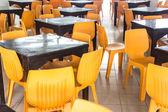 Orange chair and Brown table in food center — Stock Photo