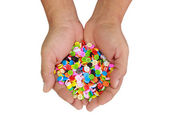 Colorful buttons, Colorful clasper in hand isolate on white b — Stock Photo