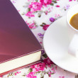Coffee  on  table with book  and rose bouquet  fabric as backgro — Stock Photo