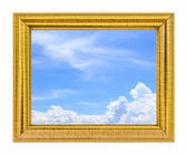 Clouds in the blue sky on golden frame — Stock Photo