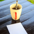 White paper note with  pen with coffee cup on the table  — Stok fotoğraf