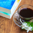Black coffee on wooden table with old books and Jasmine flower — Stock Photo