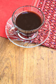 Black coffee on wooden table with handmade red tablecloth Thai s — Stock Photo