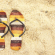 Old sandal on the sand — Stock Photo