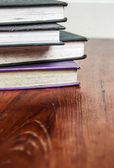 Old books on wooden tabletop — Stock Photo