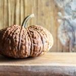 Pumpkin on wooden table — Stock Photo