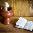 Bible and white candles on the wooden table — Stock Photo