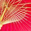 Thailand, Chiang Mai, hand painted red Thai umbrellas . — Foto Stock