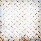 Metal rhombus shaped background and texture , with rust — Stockfoto