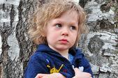 Boy at the tree — Stock Photo